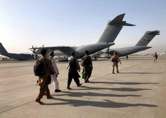 Evacuees board plane