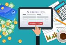 Small business bank mortgage loan or lending, online application form on flat tablet screen with hand click button isolated on desk with cash, credit card, calculator, cup of coffee, pencil, chart